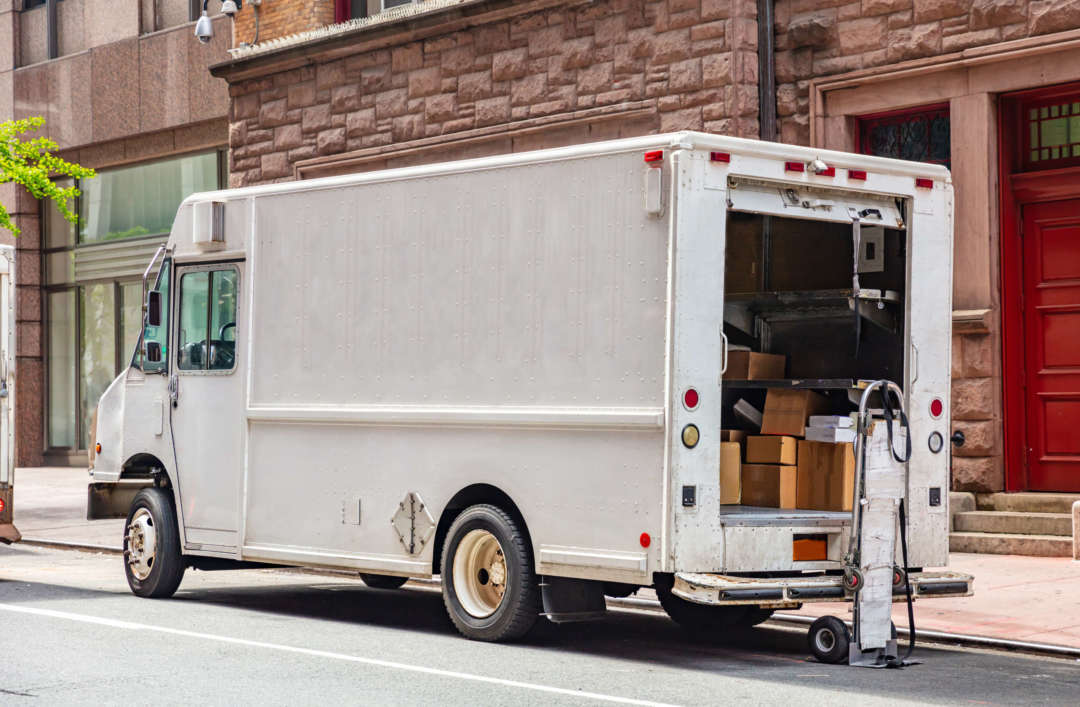 White color truck delivering packages